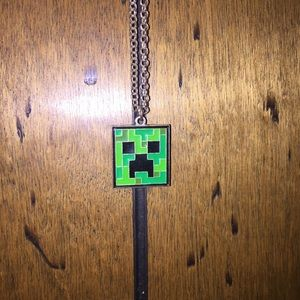 Minecraft creeper necklace.